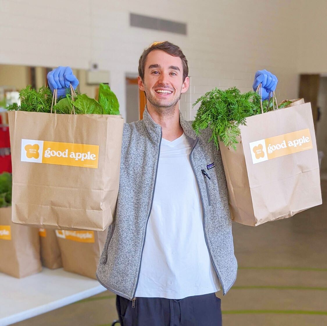 Zack holding bags